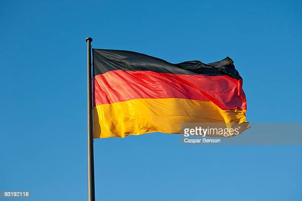 A German flag on a flag pole