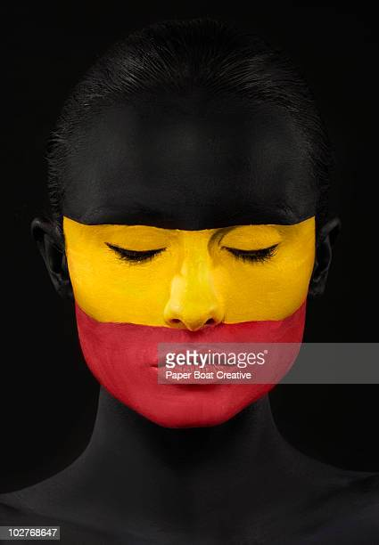 German flag painted on woman's face