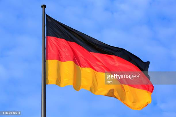 german flag (berlin, germany) - germany stock pictures, royalty-free photos & images