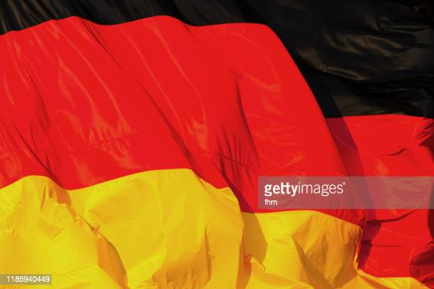 german flag (berlin, germany) - deutschland stock-fotos und bilder