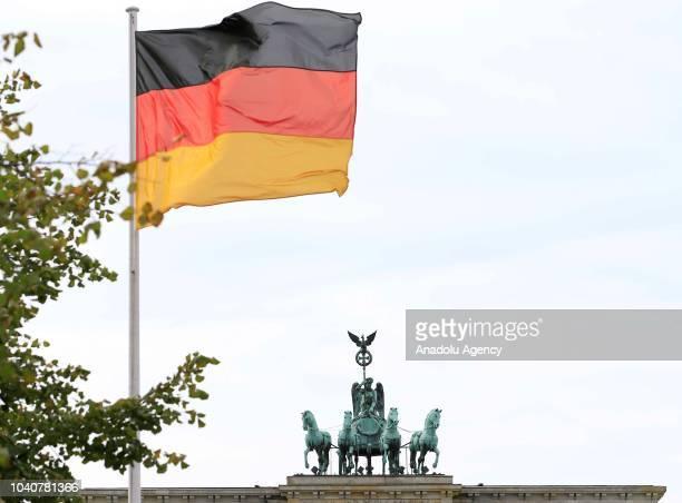 German Flag waves in front of the Brandenburg Gate ahead of Turkish President Recep Tayyip Erdogan's visit to Berlin on September 26 2018 in Berlin...