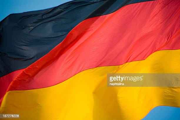 german flag waving - german flag stock pictures, royalty-free photos & images