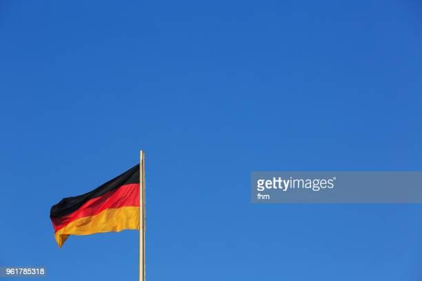 German flag with blue sky (Berlin, Germany)