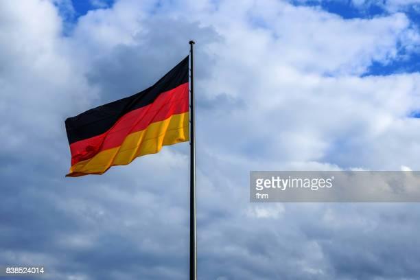 German flag with dramatic sky, Berlin, Germany