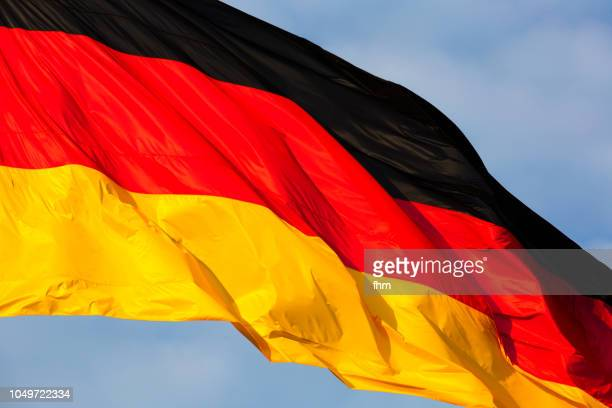 german flag with dramatic sky (berlin, germany) - tyskland bildbanksfoton och bilder