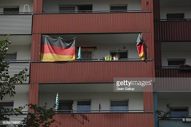 German flags hang from a balcony of an apartment building in Hellersdorf district on September 20 2016 in Berlin Germany In Berlin state elections...