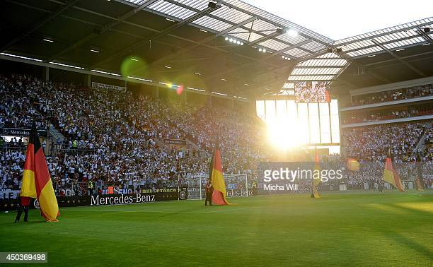 German flagwavers are seen during the international friendly match between Germany and Armenia at Coface Arena on June 6 2014 in Mainz Germany