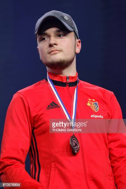 German Florian Muller 'Cody' from FC Basel poses with his silver medal after loosing the final match of the ESWC Fifa 18 Challenge against French...