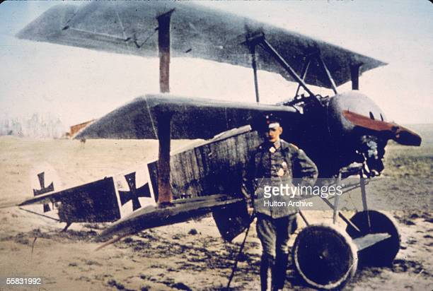 German flying ace Heinrich Gontermann stands near his Fokker DR1 triplane on an airfield Germany 1910s Gontermann who had 39 victories as a fighter...