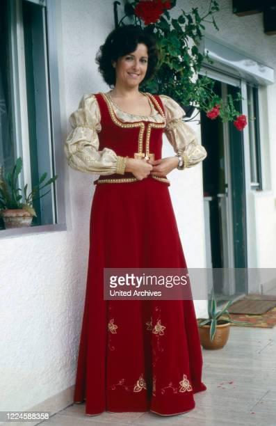 German folklore singer Lydia Huber wearing a gala array, Germany, 1970s.