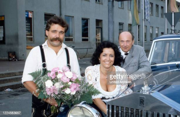 German folklore singer Lydia Huber with Bernhard Sailer and Doctor Ewald Wagner , Germany, 1980s.