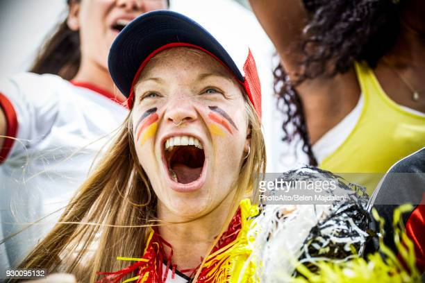 german football fan cheering at match - fan enthusiast stock pictures, royalty-free photos & images