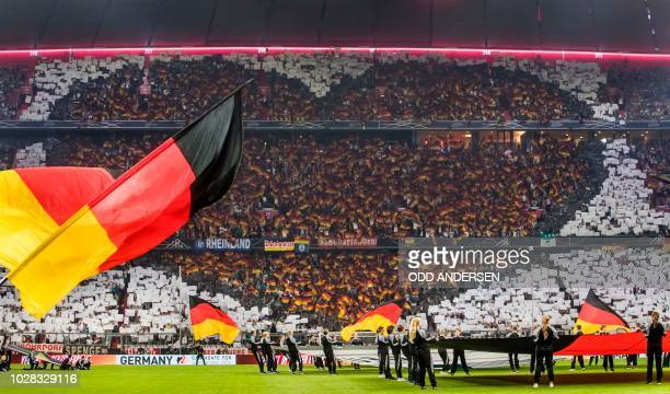 German football fans are making a heart shape tribute to their team prior to kick off in the UEFA Nations League football match Germany against...