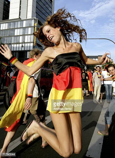 German football fans celebrate the victory in the World Cup 2006 match between Germany and Sweden on the streets on June 24 2006 in Cologne Germany...