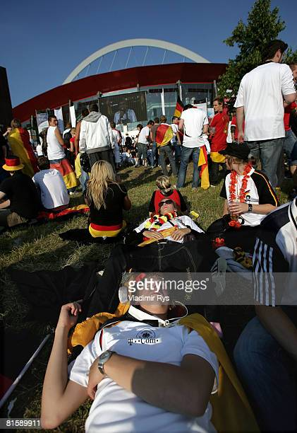 German football fans get a bit of sun tan during the public viewing of the UEFA EURO 2008 Group B match between Austria and Germany outside the...