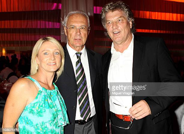 German football legend Franz Beckenbauer his wife Heidi and Michael Hartl attend the gala dinner of the Kaisercup Golf tournament on July 24 2010 in...