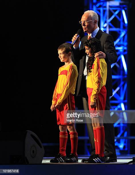 German football legend Franz Beckenbauer speaks to the audience during the kickoff celebration concert for the 2010 FIFA World Cup at the Orlando...