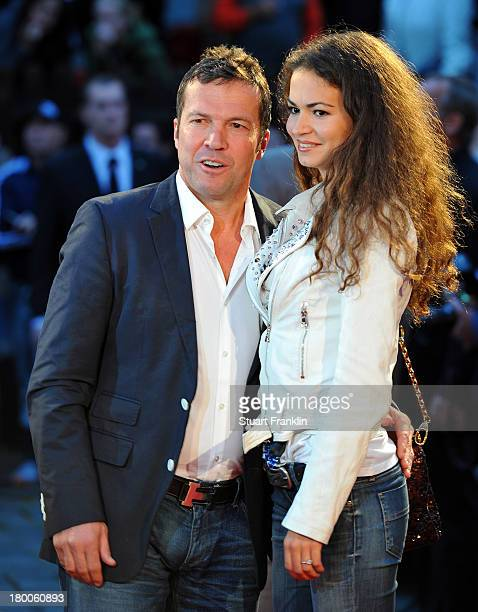 German football legend Lothar Mathaus arrives with his girlfriend Anastasia at the evening gala at Schmidt theater after the day of the legends event...