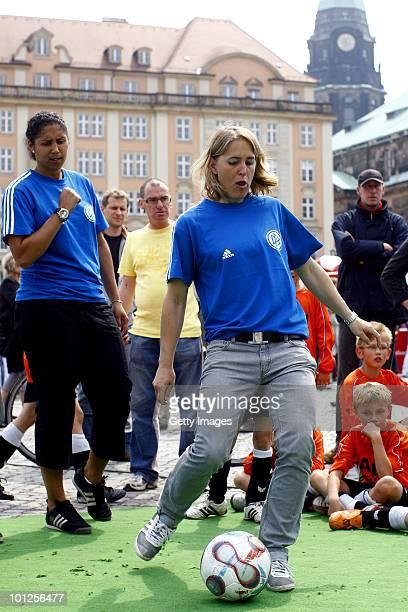 German football midfielder Britta Carlson shoots the ball next to Steffi Jones head of the Organising Committee of the FIFA Women's World Cup 2011...