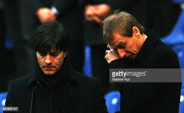 German football national team head coach Joachim Loew and former head coach Juergen Klinsmann are seen during Robert Enke's memorial service prior to...