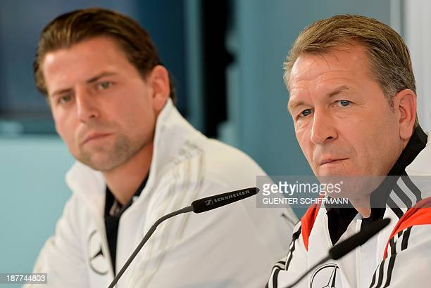 German football national team's goalkeeper Roman Weidenfeller and goalkeepers' coach Andreas Koepcke attend a press conference in the southern German...