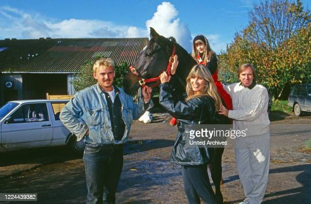 German football player Guenter Netzer his wife Elvira and daughter Alana visiting a horse stable at Sylt island Germany 1993