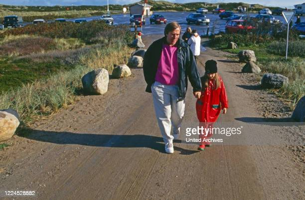 German football player Guenter Netzer with his daughter Alana at the beach of Sylt island Germany 1993