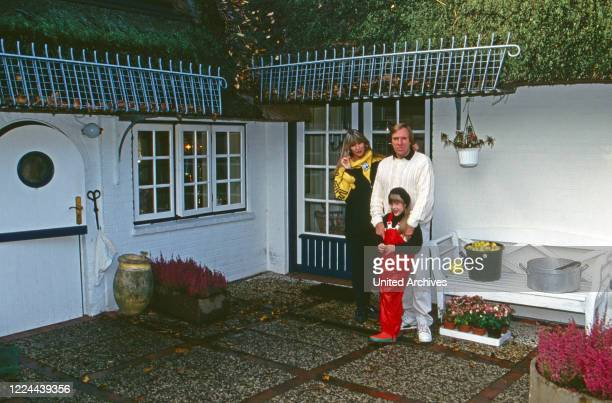 German football player Guenter Netzer with his wife Elvira and daughter Alana at Sylt island Germany 1993