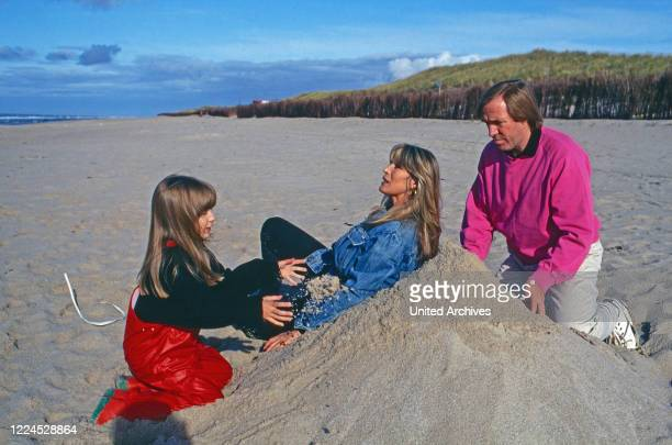 German football player Guenter Netzer with his wife Elvira and daughter Alana at the beach of Sylt island Germany 1993