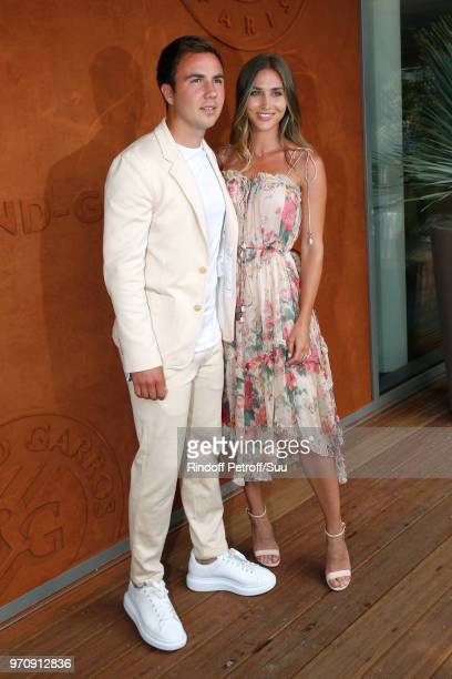 German Football player Mario Gotze and his companion Ann Kathrin Brommel attend the Men Final of the 2018 French Open Day Fithteen at Roland Garros...