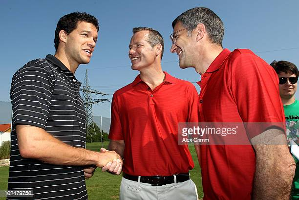 German football player Michael Ballack chats with former boxing world champion Henry Maske and Herbert Hainer CEO of German sportswear and equipment...