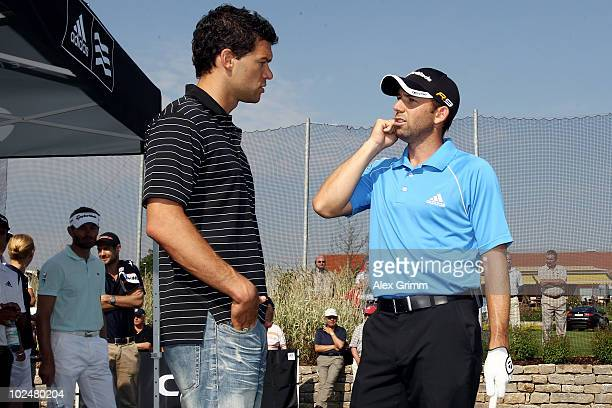 German football player Michael Ballack chats with Spanish golf professional Sergio Garcia tees off during the TaylorMadeadidas Golf ProAm tournament...