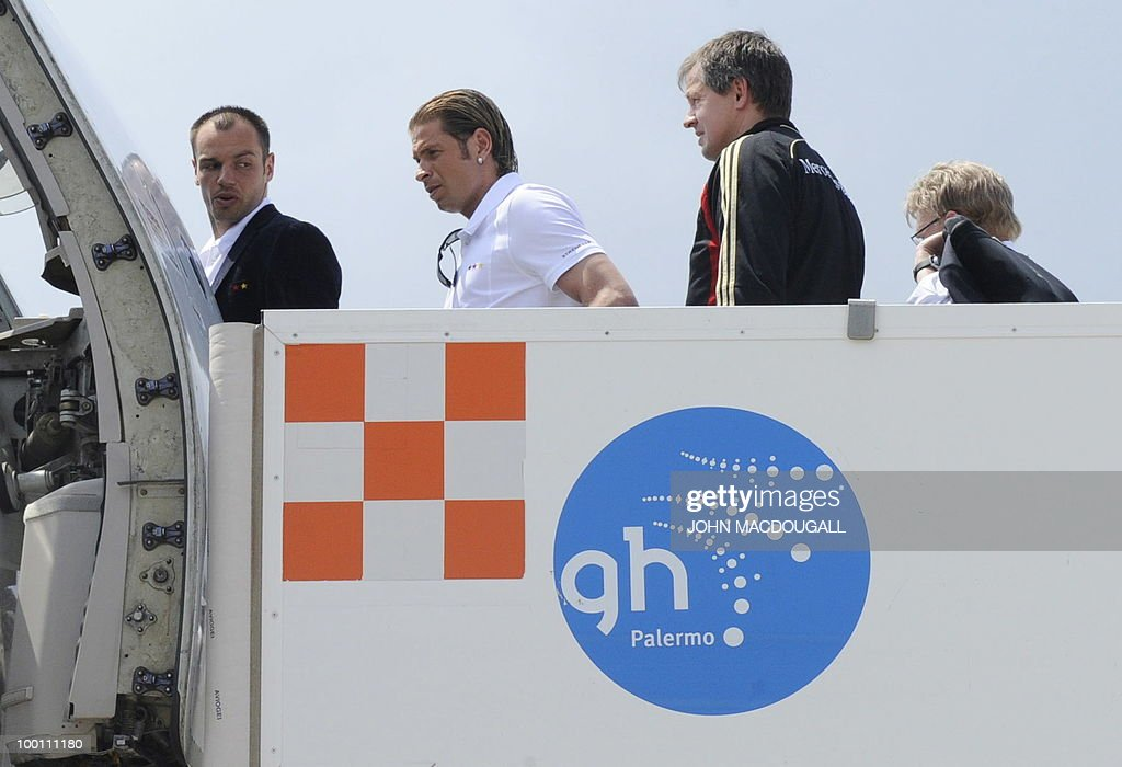 German football players Heiko Westermann (L) and Tim Wies (2nd L) board a plane in Palermo May 21, 2010, as the German football team left Sicily for a 12-day long training camp near Bolzano to prepare for the upcoming FIFA Football World Cup in South Africa.