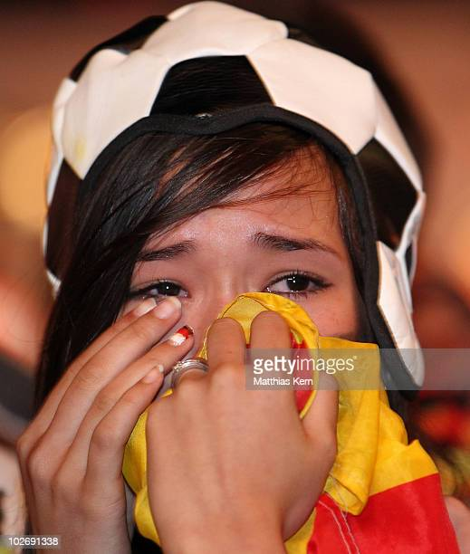 German football supporter is seen after her team lost the 2010 FIFA World Cup semi final match between Germany and Spain at a live public viewing on...