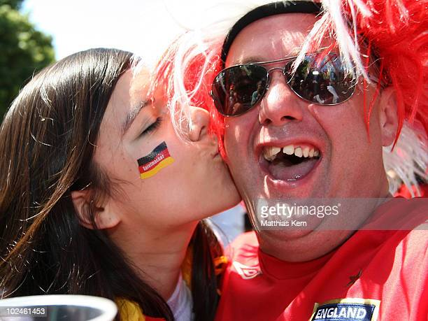 German football supporter kisses a football supporter of England prior to the 2010 FIFA World Cup round of sixteen match between Germany and England...