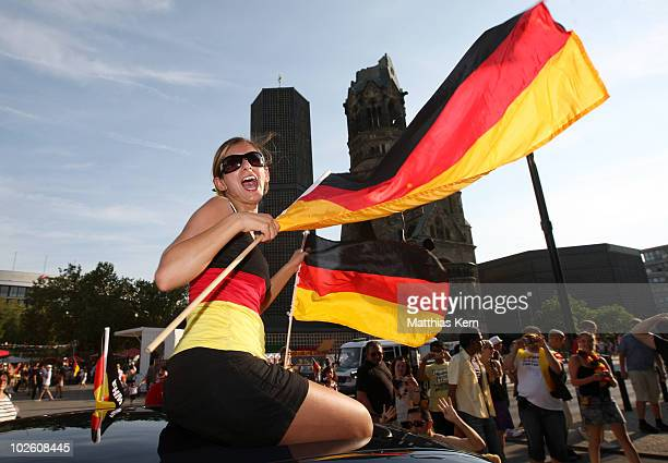 German football supporters celebrate at Kurfuerstendamm after their team win the 2010 FIFA World Cup quarter final match between Germany and...
