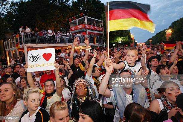 German football supporters watch the 2010 FIFA World Cup match between Germany and Ghana at a live public viewing on a large screen monitor at FIFA...