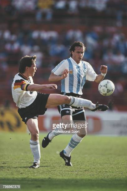 German footballer and midfielder with the Germany national football team Lothar Matthaus pictured in action clearing the ball away from Argentine...