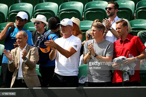 German footballer Bastian Schweinsteiger looks on as Ana Ivanovic of Serbia wins her Ladies's Singles first round match against YiFan Xu of China...