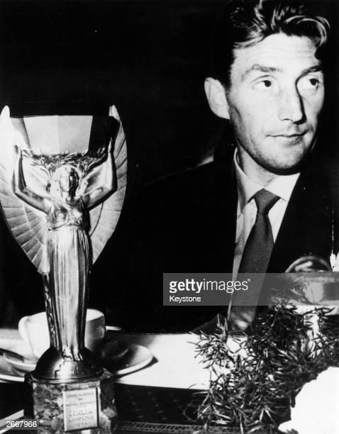 German footballer Fritz Walter with the World Cup trophy which his team won after beating Hungary 32