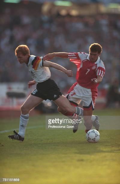 German footballer Matthias Sammer clashes with Danish footballer John Jensen during the final of the UEFA Euro 1992 Championship tournament between...