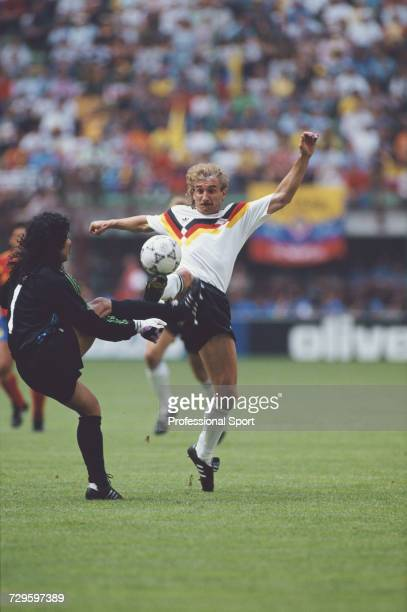 German footballer Rudi Voller clashes with Colombian goalkeeper Rene Higuita in the Group D match between West Germany and Colombia in the 1990 FIFA...