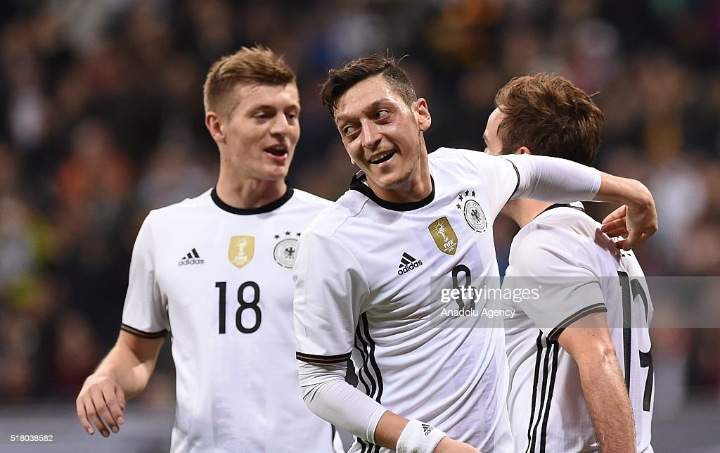 German footballers celebrate after scoring a goal during the friendly football match between Germany and Italy at the Allianz Arena in Munich, Germany on March 29, 2016.