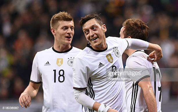 German footballers celebrate after scoring a goal during the friendly football match between Germany and Italy at the Allianz Arena in Munich Germany...