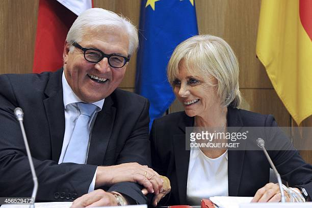 German Foreign Affair Minister FrankWalter Steinmeir talks with the French President of the Foreign affairs commission Elisabeth Guigou prior to an...