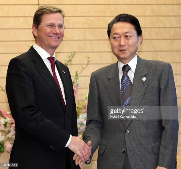 German Foreign Minister and Deputy Chancellor Guido Westerwelle shakes hands with Japanese Prime Minister Yukio Hatoyama prior to their meeting at...