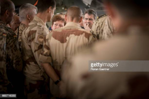 German Foreign Minister and Vice Chancellor Sigmar Gabriel and JeanMarc Ayrault Minister for Foreign Affairs of France get together with soldiers of...