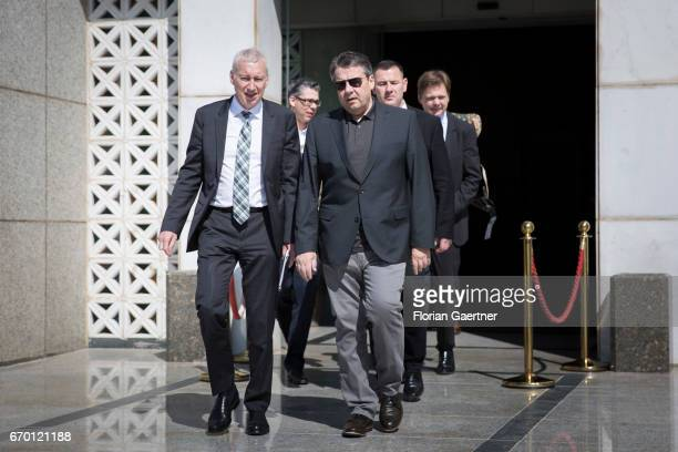 German Foreign Minister and Vice Chancellor Sigmar Gabriel and German Ambassador to Iraq Franz Josef Kremp leave a hotel on April 19 2017 in Baghdad...
