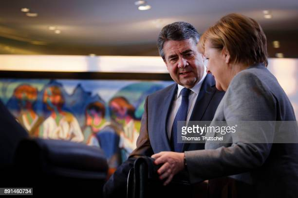 German Foreign Minister and Vice Chancellor Sigmar Gabriel and German Chancellor Angela Merkel arrives for the weekly cabinet meeting at the...