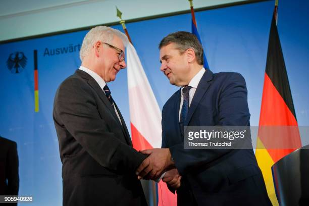 German Foreign Minister and Vice Chancellor Sigmar Gabriel and Polish Foreign Minister Jacek Czaputowicz shakes hands after their first meeting on...